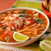 Chicken Tortilla Soup in a bowl with a lime wedge
