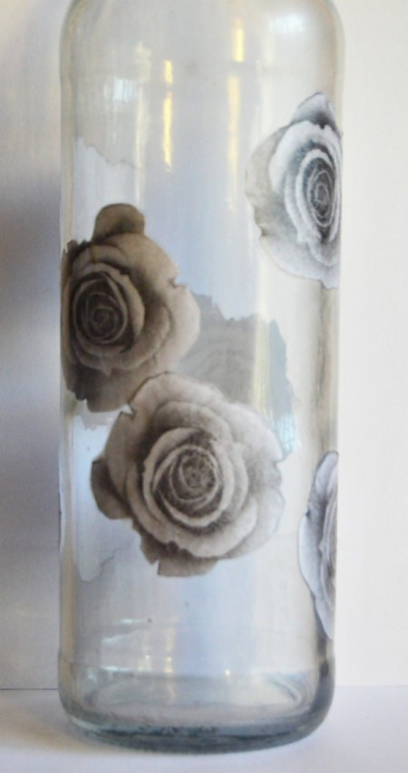 Antique Rose Upcycled Bottle Vase - apply Modge Podge to back of each rose in turn, stick to bottle apply more Mod Podge over rose and use finger to press out bubbles