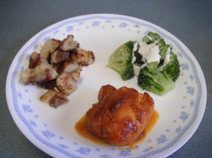 Barbecued Chicken on plate with potatoes and broccoli