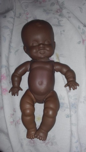 Identifying a Porcelain Doll - undressed sleeping baby doll
