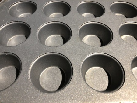 greasing muffin tin