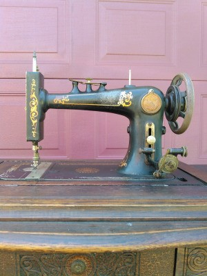Identifying an Old Treadle Sewing  Machine - old black with gold designs sewing machine