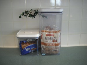 Two airtight containers holding brown sugar and bread.