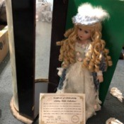 Value of an Ashley Belle Doll - doll with blond ringlets and fancy hat