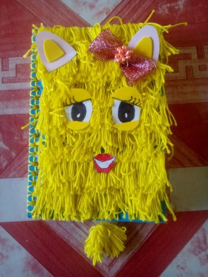DIY Fur Covered Notebook - fuzzy yellow yarn character notebook