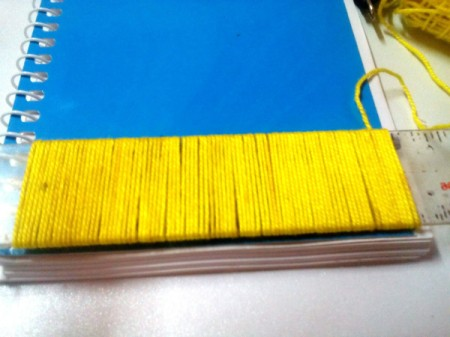 DIY Fur Covered Notebook - wrap the yard around the ruler