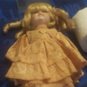 Value of a Seymour Mann Doll - blond haired doll wearing an apricot dress