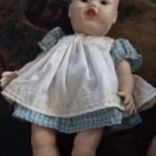 Identifying a Porcelain Doll - doll with painted on face and hair