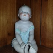 Identifying an Antique Porcelain Doll -  sitting baby doll