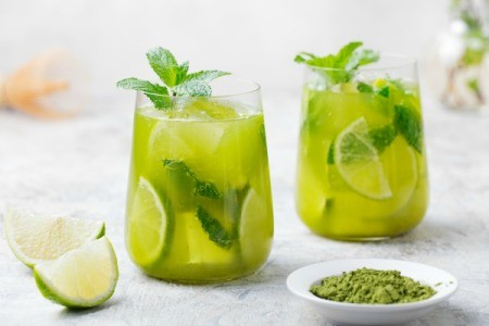 Fresh Mint Punch in glasses with lime slice
