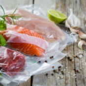 Beef, chicken and salmon in vacuum plastic bag.