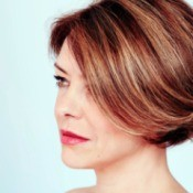 Woman with short highlighted hair.