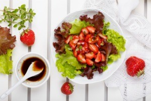 Strawberry salad with a balsamic dressing.