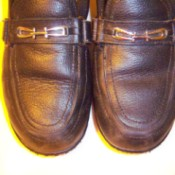 Leather shoes newly polished with candle wax.