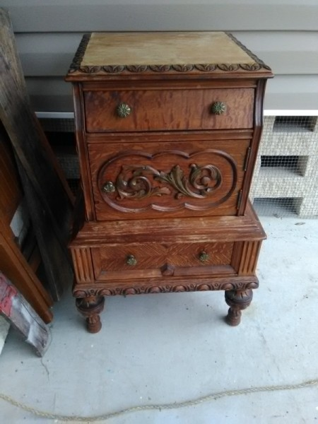 Value of an Ornately Carved End or Bedside Table