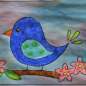 Naïve Spring Bird Greeting Card - mix up food coloring diluted with water and paint the background allowing colors to merge allow to dry