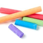 Colorful pieces of chalk on white background