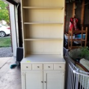 Dating Ethan Allen Furniture - white shelf unit with drawers and door at the bottom
