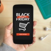 Hand holding phone with a Black Friday Ad on it.