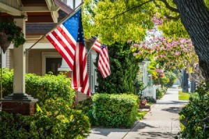American Flags on houses in a neighborhood.