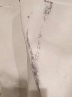 Removing Dye Transfer from Faux Leather Coat - black dye on white coat