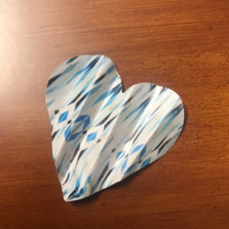 Making Confetti from Magazines and Shopping Catalogs - folded heart to use as gift packing