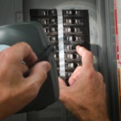 Man fixing Circuit Breaker