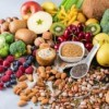 Collection of high fiber foods like vegetables, fruit, and nuts.