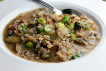 Mushroom and Wild Rice Soup in a white bowl with a spoon