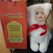 Value of Ashley Belle Porcelain Dolls - doll in fuzzy white suit