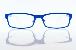 Blue eyeglass frames on white background.