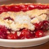 Close up of a slice of cherry pie.