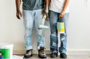 Two people with paint stains on their jeans.