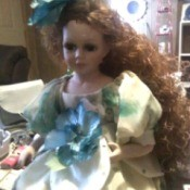 Value of a Cathay Collection Porcelain Doll - poor quality photo of doll with long curly hair