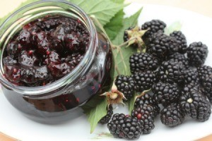 Blackberry Jam in a jar next to fresh blackberries