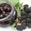 Blackberry Jam in a jar next to fresh blackberries
