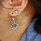 Silver earring in a woman's ear