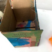 Recycled Cardboard Box as a Child's Canvas - painted shipping box