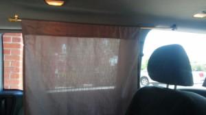 A curtain in a minivan.