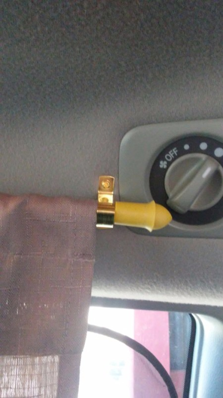 The hardware for a curtain rod in a minivan.