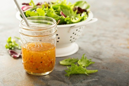 Italian vinaigrette dressing in a mason jar.