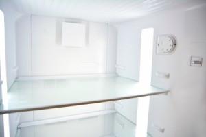 Inside an empty fridge.