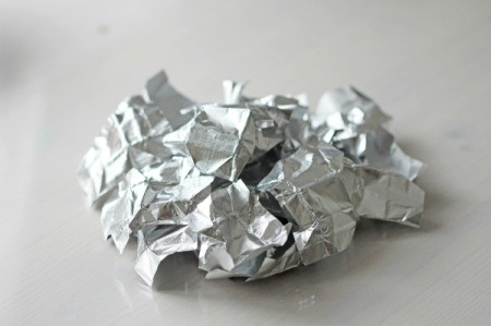 Crumpled Aluminum Foil sitting on a table