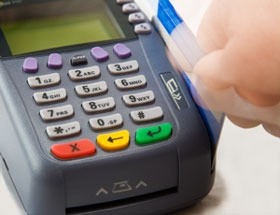 A credit card machine for a purchase.