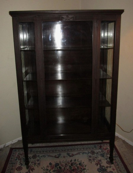 Value of an Antique China Cabinet - dark wood, glass fronted cabinet - Value Of An Antique China Cabinet ThriftyFun