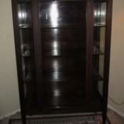Value of an Antique China Cabinet - dark wood, glass fronted cabinet