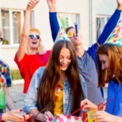 Teens having a party outside.