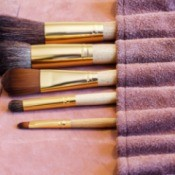 Makeup brushes in a roll-up case.