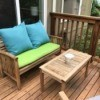 Teak furniture on a deck outdoors.