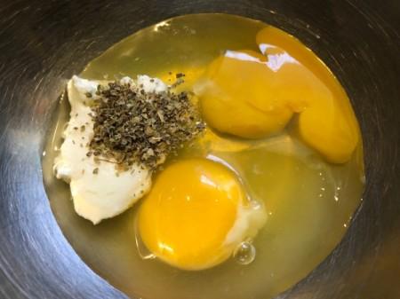 eggs, yogurt and marjoram in bowl
